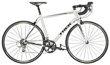 ВелосипедШоссейные<br>Шоссейный велосипед Trek 1.5 2015. Велосипед оборудован алюминиевой рамой. Установленны жесткая вилка Trek carbon road, ободные механические тормоза, а также профессиональное оборудование. Trek 1.5 2015 предназначен для скоростного катания по ровным дорожным покрытиям.<br> <br> Рама и амортизаторы<br> <br> Рама: 100 Series Alpha Aluminum<br> Вилка: Trek carbon road<br> Цвета: Trek Black<br> <br> Цепная передача<br> <br> Манетки: Shimano Tiagra STI, 10 speed<br> Передний переключатель: Shimano Tiagra<br> Задний переключатель: Shimano Tiagra<br> Шатуны: FSA Vero, 50/34 (compact)<br> Кассета: Shimano Tiagra 12-30, 10 speed<br> Педали: Nylon body w/alloy cage<br> <br> Колеса<br> <br> Обода: Alloy hubs w/Bontrager Approved alloy rims<br> Покрышка: Bontrager R1 Hard-Case Lite, 700x23c<br> <br> Компоненты<br> <br> Передний тормоз: Alloy dual-pivot<br> Задний тормоз: Alloy dual-pivot<br> Грипсы: Bontrager Gel Cork tape<br> Руль: Bontrager Race VR-C, 31.8mm<br> Вынос: Bontrager SSR, 31.8mm, 10 degree<br> Рулевая колонка: 1-1/8 semi-cartridge bearings<br> Седло: Bontrager Affinity 1<br> Подседельный штырь: Bontrager Approved, 27.2mm, 8mm offset<br><br>Пол: Мужской<br>Возраст: Взрослый