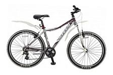 ВелосипедГорные спортивные<br>Женский спортивный велосипед Stels Miss 7300 2014 год – это эргономичная и качественная модель, которая собрана на основе стильной, прочной и лёгкой алюминиевой рамы, укомплектована надежным навесным оборудованием, имеет превосходный современный дизайн. На велосипеде Stels Miss 7300 имеется 21 скорость, а для обеспечения безопасности он оснащен качественными тормозами. Представленная вашему вниманию модель гарантированно станет верным спутником каждой любительнице велокатания – как на городских улицах и парковых аллеях, так и на лесных тропах и пересечённой местности.<br><br>Рама и амортизаторы<br><br>Рама: алюминий<br>Вилка: XCM, SR SUNTOUR, ход 100мм<br><br>Цепная передача<br><br>Манетки: ST-EF51, SHIMANO, Tourney<br>Передний переключатель: FD-TX50, SHIMANO Tourney<br>Задний переключатель: RD-M310, SHIMANO Altus<br>Шатуны: SR SUNTOUR, сталь, 24/34/42 зубьев<br>Каретка: VP, картридж<br>Количество скоростей: 21<br>Педали: алюминий/сталь<br><br>Колеса<br><br>Обода: ZAC2000, WEINMANN, алюминий, двойные<br>Bтулка: JOY TECH, алюминий<br>Покрышка: H-5119, CHAOYANG, 26x2.0 60 TPI<br><br>Компоненты<br><br>Передний тормоз: C310, TEKTRO,V-brake<br>Задний тормоз: C310, TEKTRO,V-brake<br>Рулевая колонка: VP<br>Седло: Cionlli<br><br>Пол: Женский<br>Возраст: Взрослый